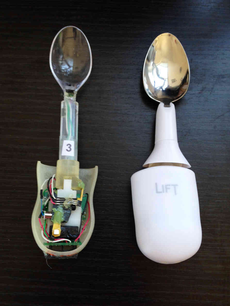"The Liftware device, shown here as an early prototype (left) and the final design, starts up automatically when it's lifted from the table. There's no ""on"" switch to fumble with."