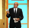 "Larry Wilmore accepts the best talk show award for ""The Daily Show with Jon Stewart"" at the Critics' Choice Television Awards in June 2013."
