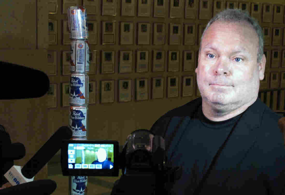 Chaz Stevens talks with reporters after setting up his Festivus pole made out of beer cans at the Florida Capitol building in Tallahassee, Fla., in December of 2013.