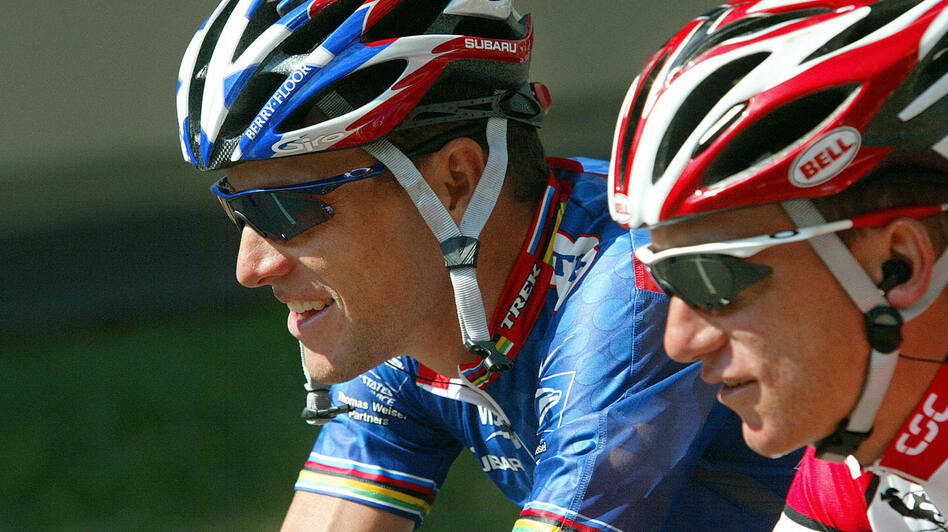 Lance Armstrong (left) and Tyler Hamilton compete in the 90th Tour de France in 2003. Hamilton later testified in the doping case brought against Armstrong and the U.S. Postal cycling team. (Franck Fife /AFP/Getty Images)
