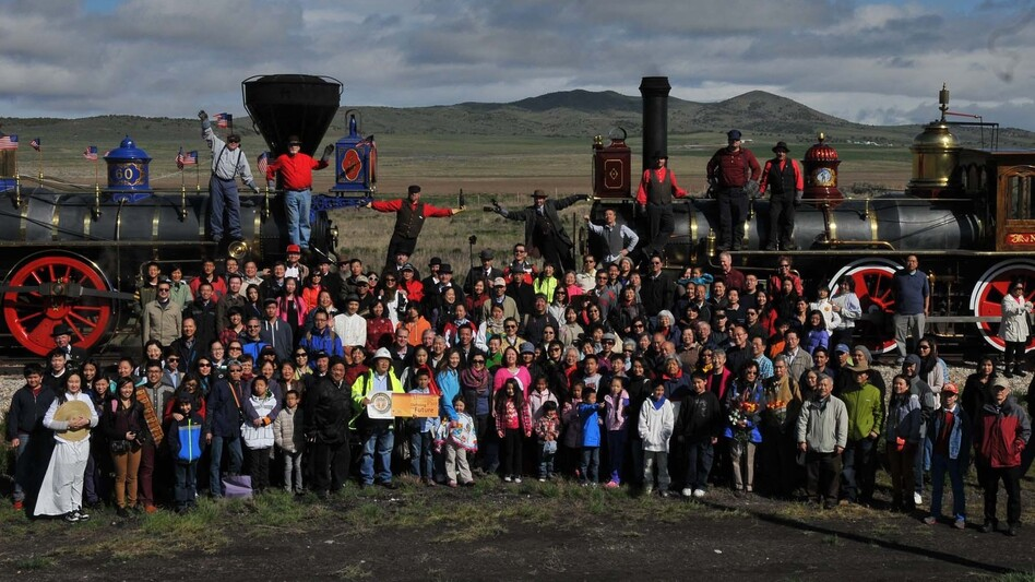 A group of Asian-Americans, including descendants of Chinese railroad workers, recreated an iconic photo on the 145th anniversary of the first transcontinental railroad's completion at Promontory Summit, Utah. (Courtesy of Corky Lee)