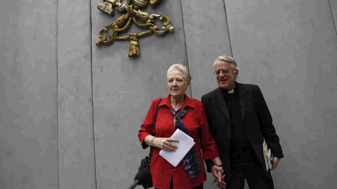 Marie Collins (left) and Vatican spokesman father Federico Lombardi leave at the end of a press conference at the Vatican on May 3, 2014. Collins, a clergy abuse survivor, was chosen as a member of Pope Francis' abuse advisory board.