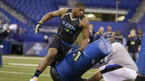 Michael Sam runs a drill at the NFL Scouting Combine in Indianapolis in February. Sam was picked in the seventh round of the NFL draft by the St. Louis Rams.
