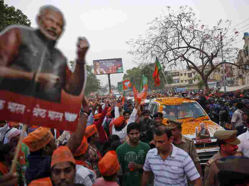 Supporters of Narendra Modi, the Hindu national leader running for prime minister, crowd his car as he travels to his party's election office in Varanasi.