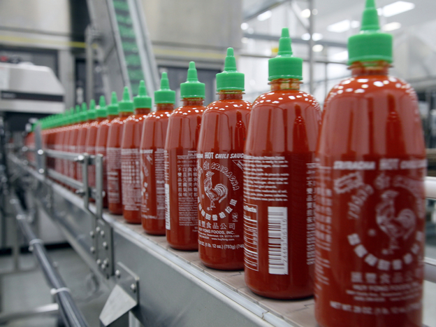 Sriracha chili sauce is produced at the Huy Fong Foods factory in Irwindale, Calif. CEO David Tran has been at odds with the local City Council over the smells emitted by the sauce factory.
