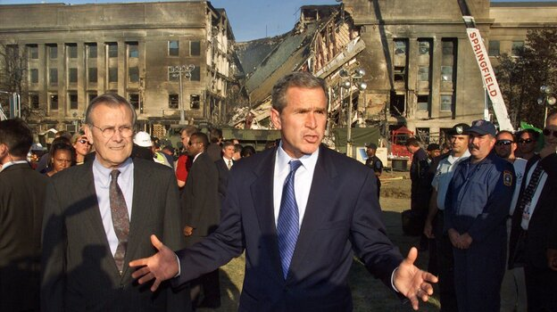 President George Bush examines the devastation at the Pentagon with Secretary of Defense Donald Rumsfeld on Sept. 12, 2001, a day after a hijacked airliner slammed into the building.