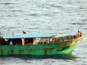 An Italian navy photo from March, showing a migrant boat from North Africa intercepted off the coast of Sicily.