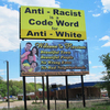 Several white supremacist groups have roots near Harrison, Ark. Residents believe a yellow billboard in town is a reaction to a local effort to make the town more inclusive.