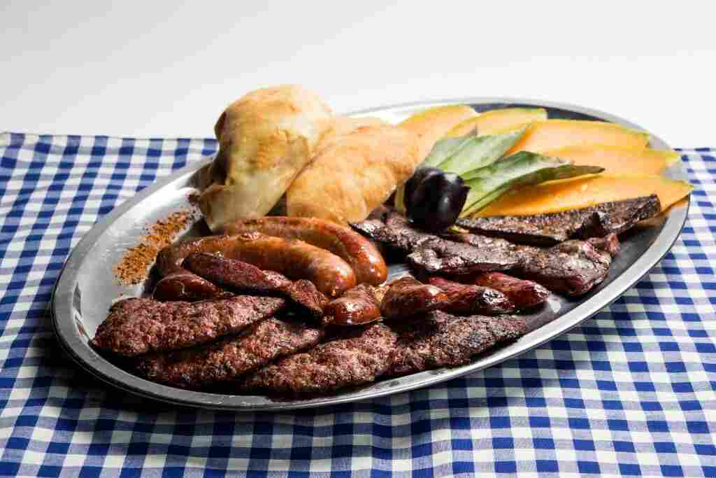 Romani Kafenava in Maribor, Slovenia, serves grilled meats, a typical Roma dish.