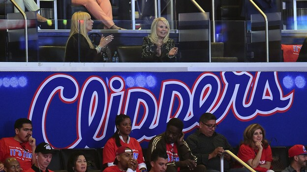Shelly Sterling (top right), wife of embattled L.A. Clippers owner Donald Sterling, watches Friday's Game 3 of the Clippers playoff series. The NBA says that if Donald Sterling is forced out, his wife cannot keep the team, either. (AFP/Getty Images)
