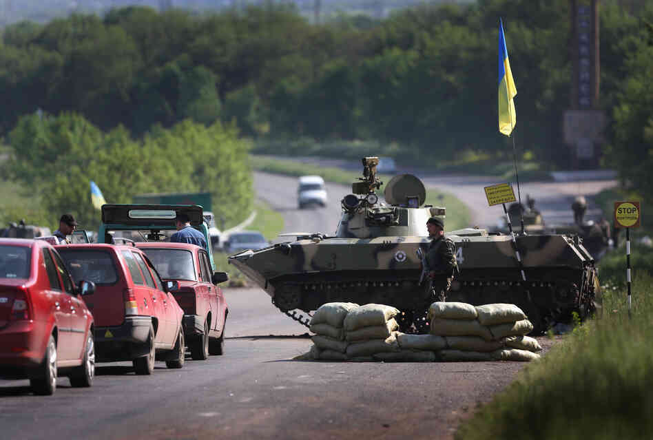 Ukranian soldiers stop cars at a highway checkpoint near Slovansky, Ukrain