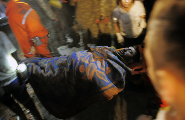 A rescued miner is carried away after an explosion and fire at a coal mine in Soma, Turkey, on Tuesday.