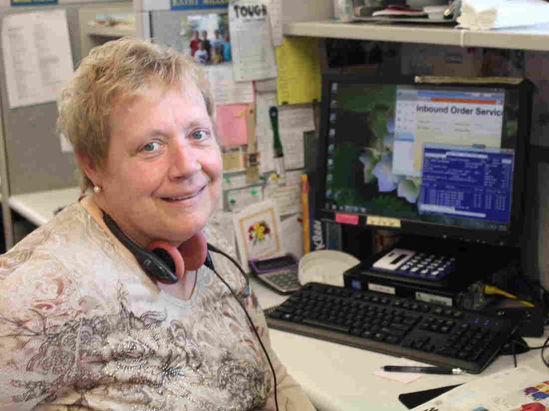 Kathy Miller takes calls for orders in AmeriMark's order processing unit.