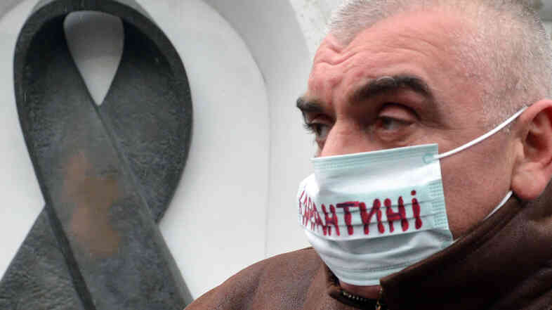 "The mask of this Kiev protester (at a 2012 demonstration demanding more funding for HIV treatment) reads ""quarantine."" There are enough drugs to treat only half the HIV patients in Ukraine."