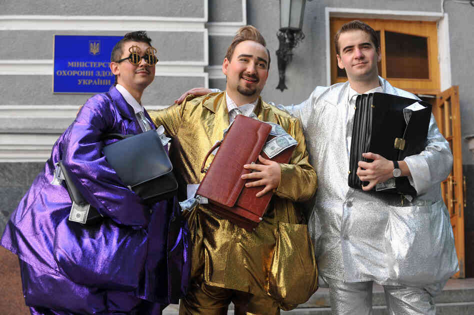 "Fashion designer Oleksiy Zalevsky created ""uniforms for the corrupt"" during a symbolic fashion show in front of Ukraine's Health Protection Ministry in Kiev in 2009."