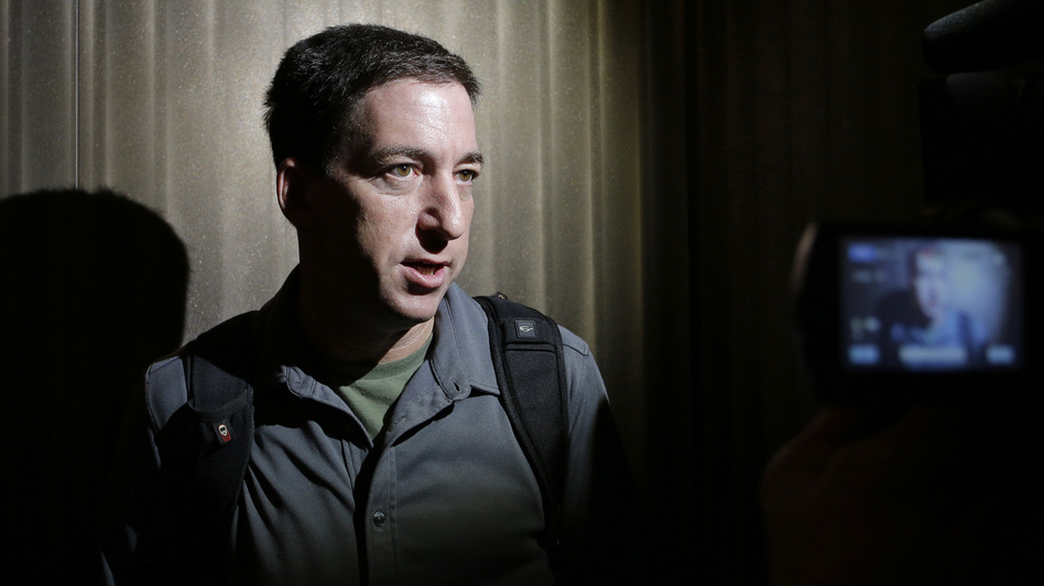 Reporter Glenn Greenwald speaks to reporters in Hong Kong on June 10, 2013, just days after publishing a series of reports about the NSA's mass surveillance programs.