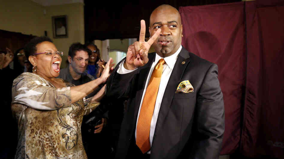 Ras Baraka (right) is greeted by supporters after casting his vote Tuesday in Newark, N.J. Baraka defeated Shavar Jeffries, a former state assistant attorney general, for the mayoral office Cory Booker occupied from 2006 until October 2013.