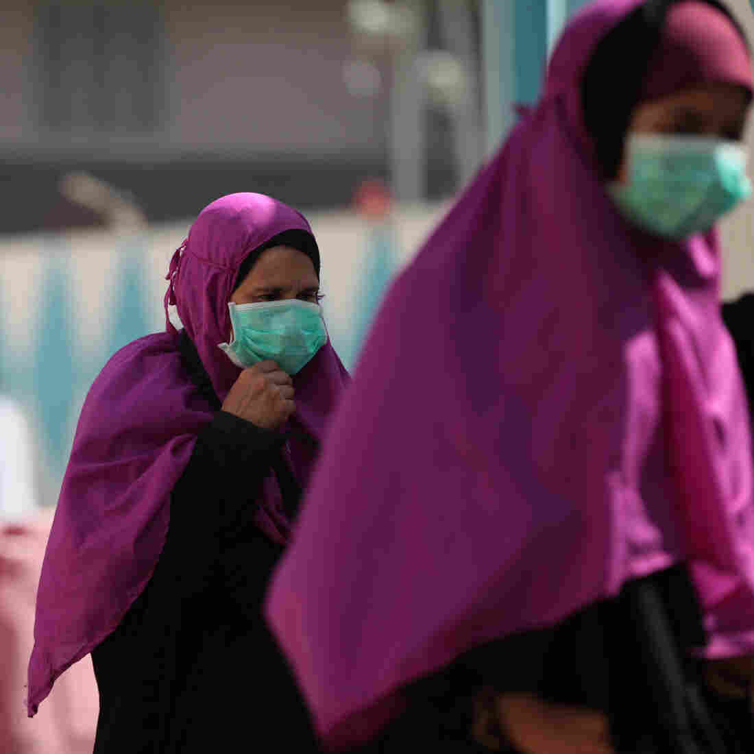 Muslim pilgrims wear masks to prevent infection from the Middle East respiratory syndrome in the holy city of Mecca, Saudi Arabia, on Tuesday.