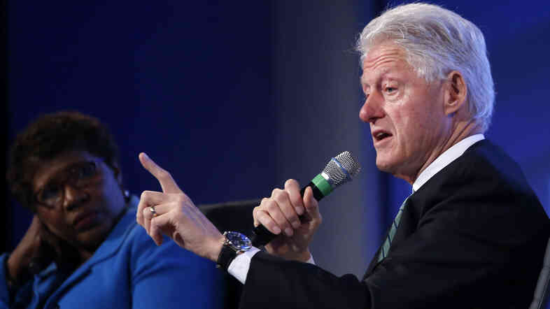 Former President Bill Clinton answers questions Wednesday from Gwen Ifill of PBS NewsHour at the 2014 Fiscal Summit organized by the Peter G. Peterson Foundation in Washington.