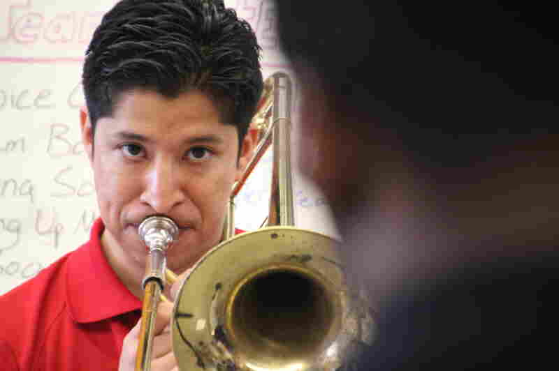 Christopher Herrero, a tuba player at Karr a decade ago, was hired as band director four years ago.