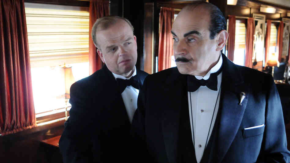 David Suchet (right) as detective Hercule Poirot in an adaptation of Agatha Christie's Murder on the Orient Express.