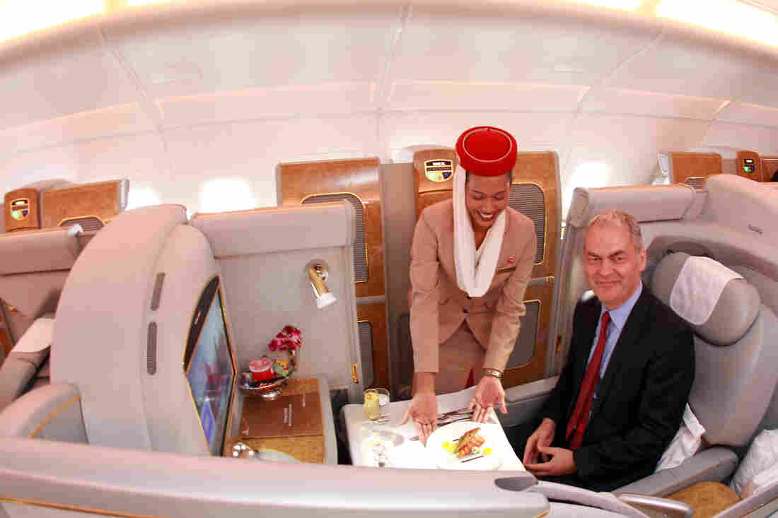 Emirates executive Thierry Antinori poses for the camera in a first-class seat aboard an Airbus A380 in Munich in 2011.