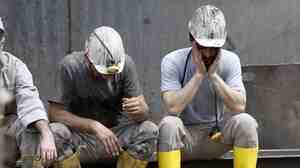 Miners rest Thursday during a break in the rescue operation after a mine explosion near Soma, Turkey.