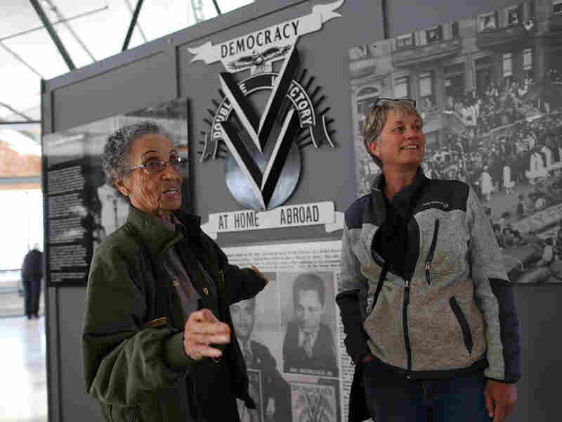 National Park Service ranger Betty Reid Soskin, left, talks with a visitor at the Rosie the Riveter World War II Home Front National Historical Park on Oct. 24, 2013. in Richmond, Calif. Soskin leads tours, speaks to groups and answers questions about living and working in the area during WWII.
