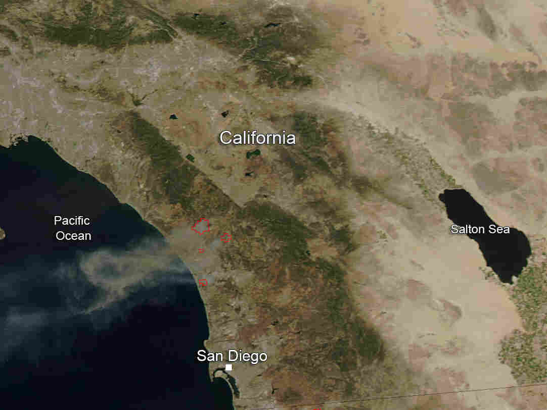 An image shot by NASA's Moderate Resolution Imaging Spectroradiometer (MODIS) aboard the Aqua satellite on Wednesday. It shows multiple wildfires in Calif. trailing smoke into the Pacific Ocean.