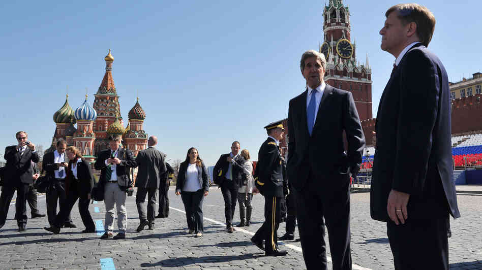 U.S. Secretary of State John Kerry, second right, speaks with U.S. Ambassador to Russia Michael McFaul during a walk in Moscow's Red Square in May 2013.