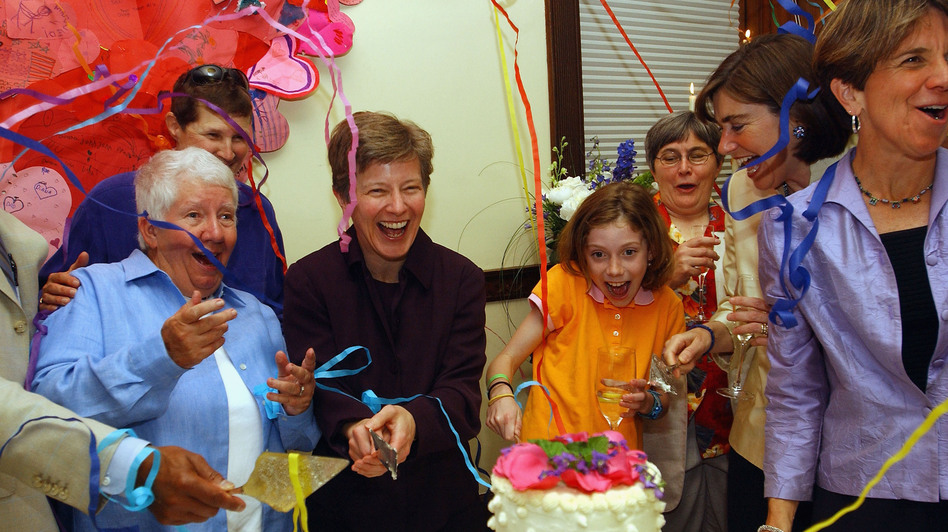 Bonauto celebrates on May 17, 2005, the one-year anniversary of legal same-sex marriage in Massachusetts. Bonauto argued the case that benefited couples like Hillary and Julie Goodridge (at right), here with their daughter Annie. (Getty Images)