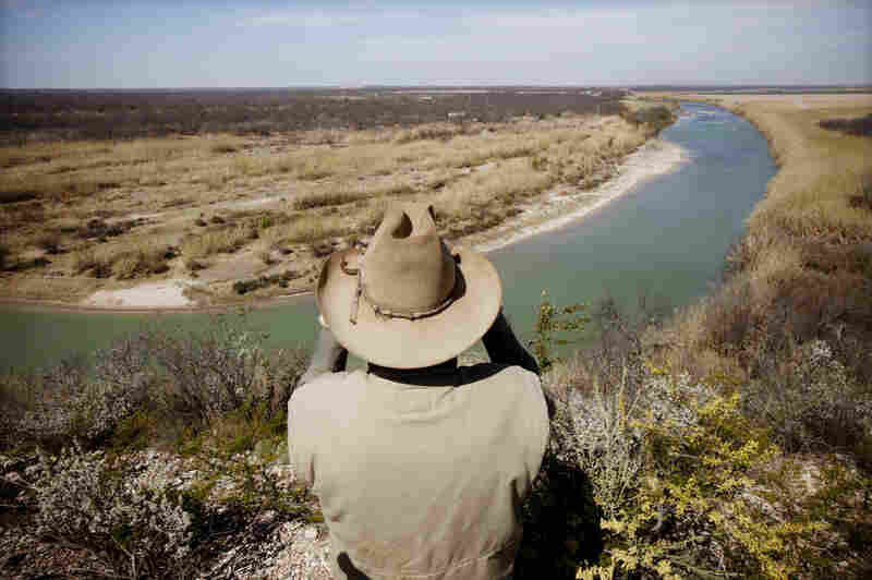 Dob Cunningham lives on a ranch across from the Rio Grande, outside Eagle Pass, Texas. He says his property is periodically flooded with border crossers.