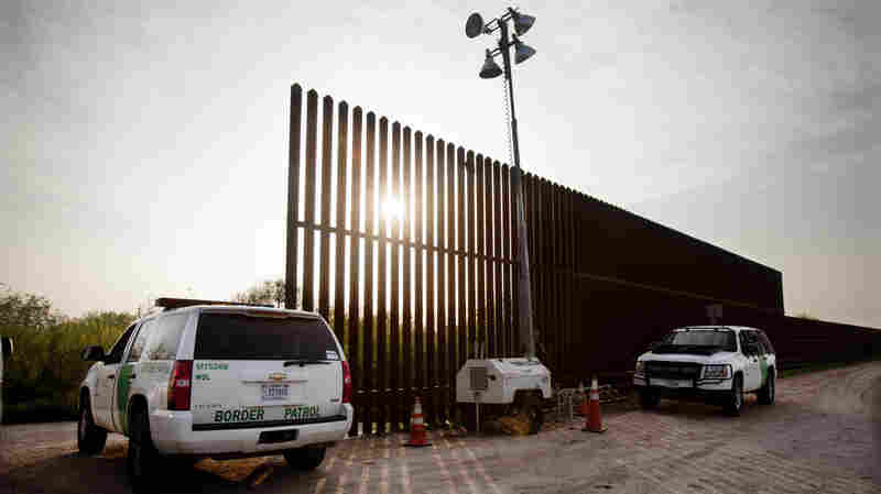 United States border patrol agents monitor a fence in Hidalgo, Texas. Two congressmen, from Texas and New Mexico, are seeking a review of some agency policies.