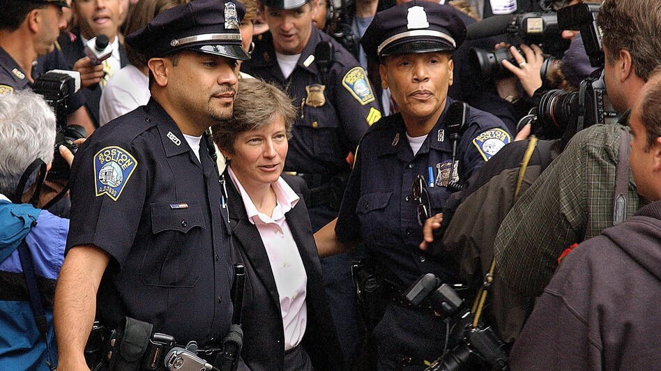 The morning of May 17, 2004, attorney Mary Bonauto headed into City Hall in Boston, where some of the plaintiffs in the state's same-sex marriage suit were applying for a marriage license. There were supporters and opponents on the plaza that day. (Courtesy of InfinityPortraitDesign.com)