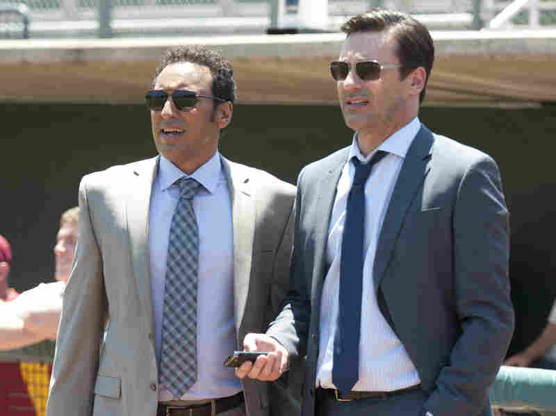 Aasif Mandvi (left) and Jon Hamm check out the talent in Million Dollar Arm.