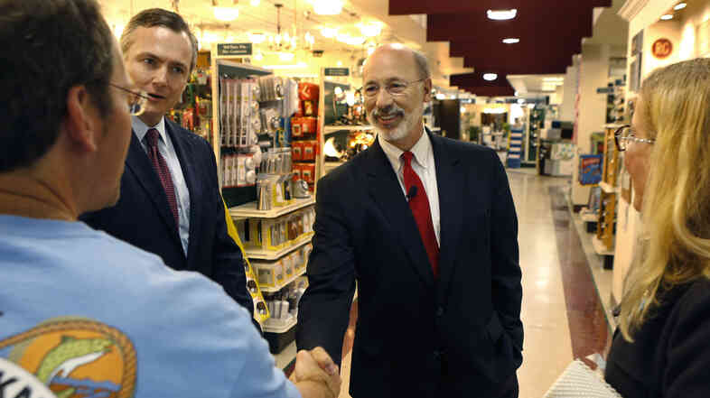 Tom Wolf, who leads in polls for Pennsylvania's Democratic gubernatorial nomination, shakes hands with a customer at a Mount Lebanon, Pa., hardware store on Thursday.