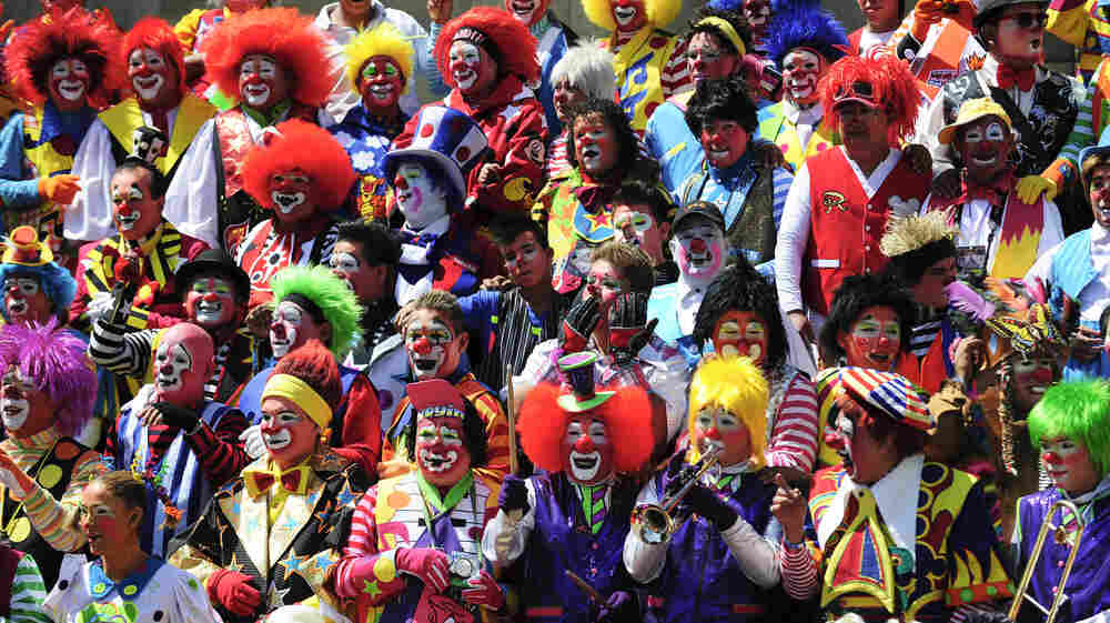 Clowns pose for a picture during the XVII International Clown Convention in Mexico City, on October 24, 2012. At least 500 clowns are taking part in the event.