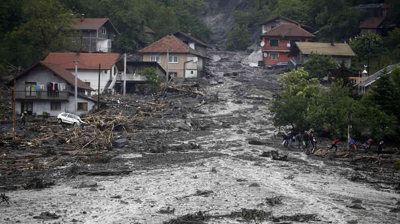 Flooded houses in Topcic Polje, near Zepce, in Bosnia, on Friday. The heaviest rains and floods in 120 years have hit Bosnia and Serbia, killing at least four people and forcing hundreds out of their homes.