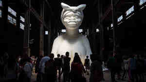 "Viewers of Kara Walker's A Subtlety described the sculpture as ""beautiful"" and ""the American sphinx."" Another said, ""She is so exposed and she's so vulnerable, but at the same time she has some grace and majesticness that is completely unapproachable."""