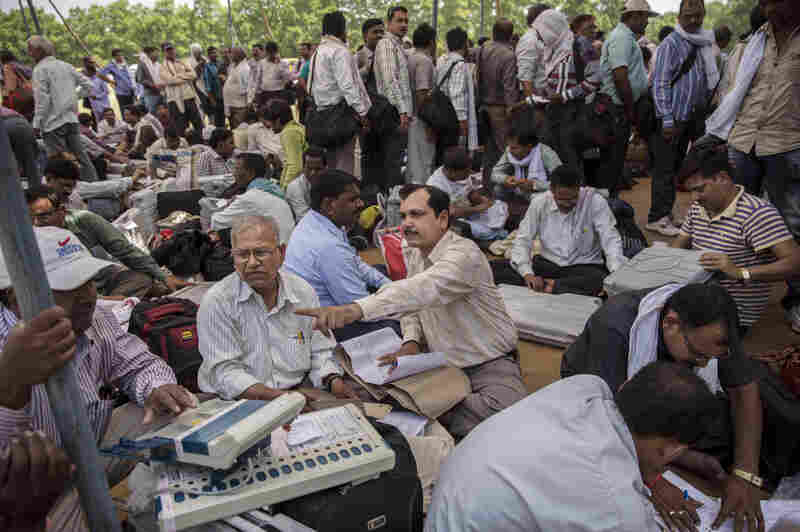 Indian election workers learn to use and check electronic voting machines on May 11.
