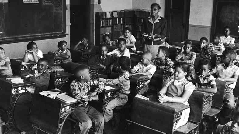 This racially segregated Monroe Elementary School class from March 1953 shows Linda and Terry Lynn Brown, who, with their parents, initiated the Brown v. Board of Education case that helped propel school integration.