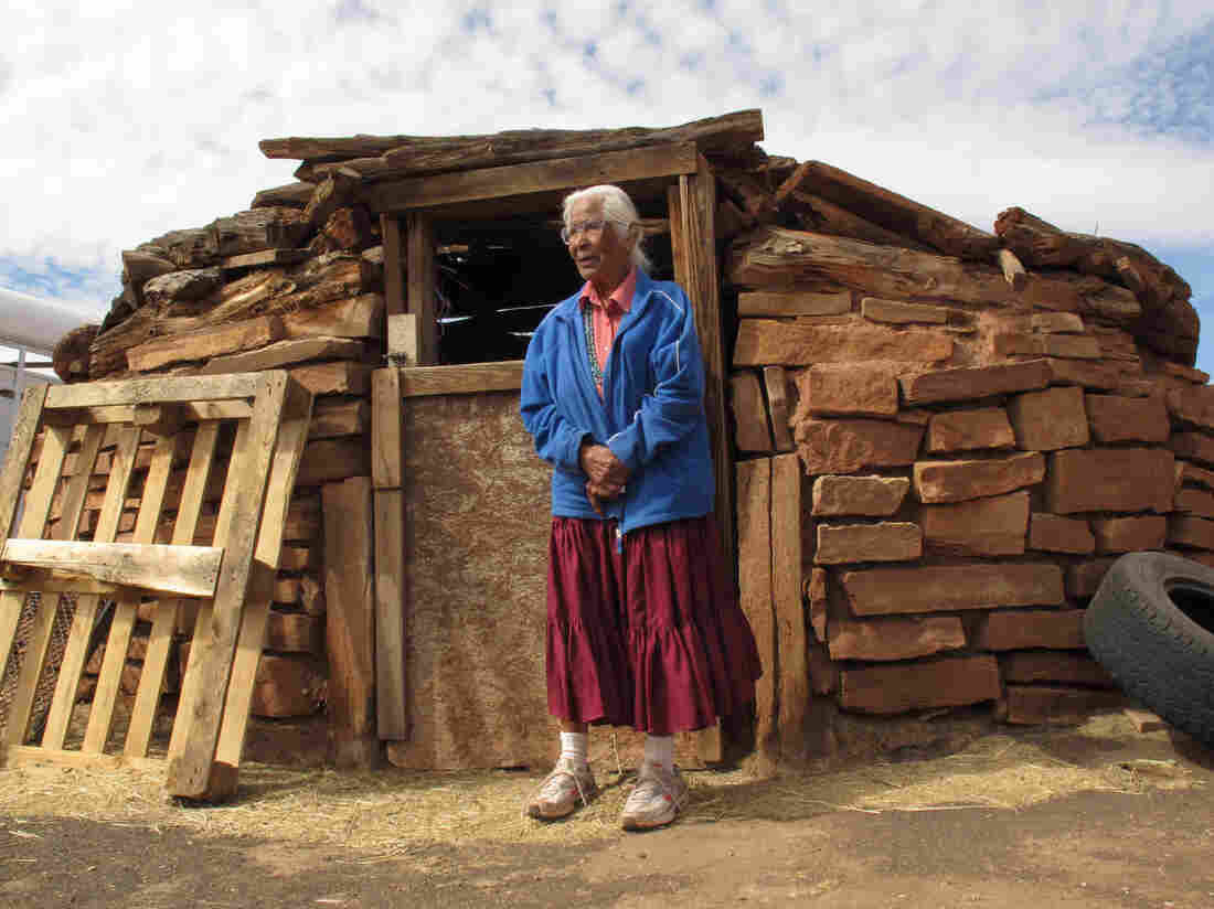Navajo elder Stella Peshlakai Smith, 89, stands at a traditional dwelling on her homestead at Wupatki National Monument in 2014. The National Park Service says her children cannot stay when she dies.