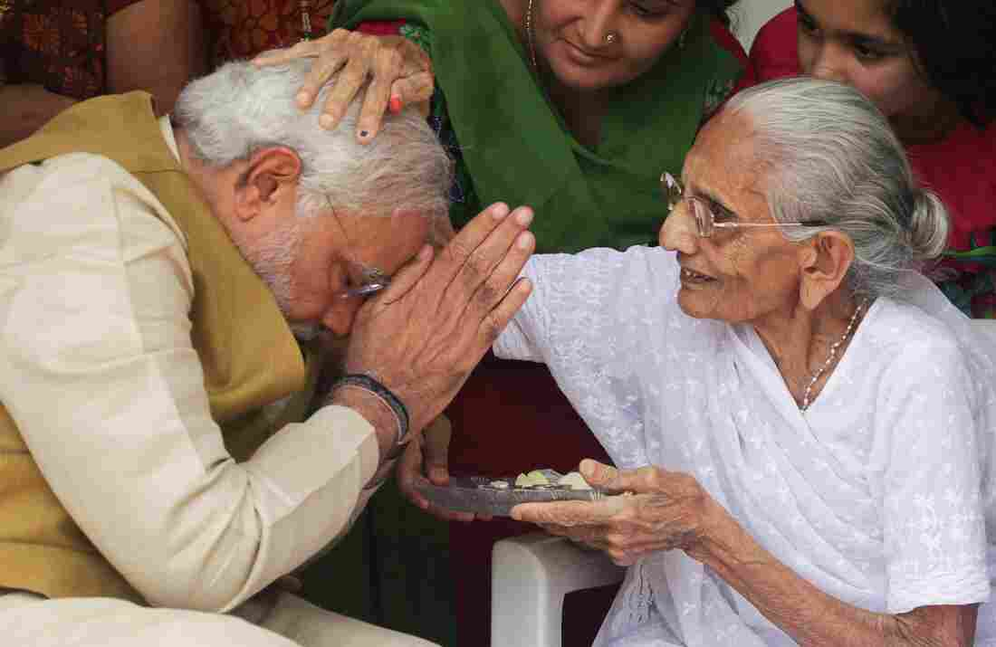 India's next prime minister, Narendra Modi, receives a blessing from his mother a