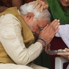 India's next prime minister, Narendra Modi, receives a blessing from his mother at her home in the western state of Gujarat on Friday, as election results showed a resounding win for Modi's opposition party.