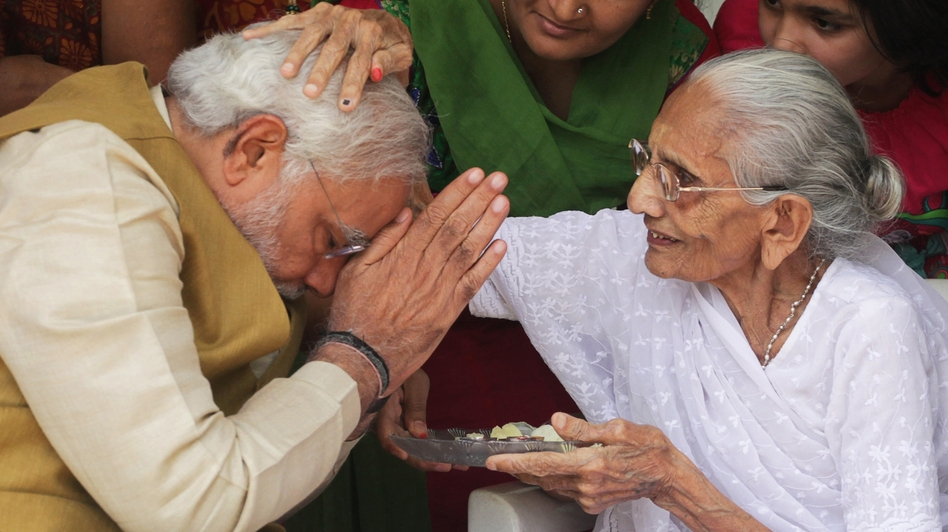 India's next prime minister, Narendra Modi, receives a blessing from his mother at her home in the western state of Gujarat on Friday, as election results showed a resounding win for Modi's opposition party. (AP)