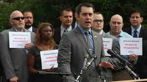 Tom Tarantino, chief policy officer at Iraq and Afghanistan Veterans of America, speaks at a news conference on Capitol Hill Thursday about holding the Department of Veterans Affairs accountable.