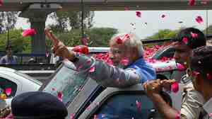 Hundreds of flag-waving supporters mobbed Indian Prime Minister-elect Narendra Modi as he arrived in New Delhi.