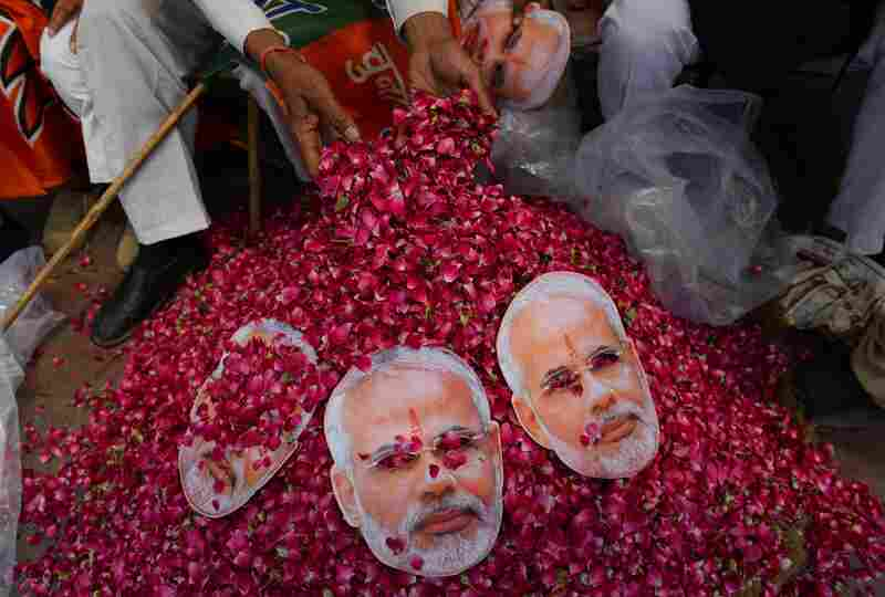 An Indian supporter of Modi collects flowers on Saturday.