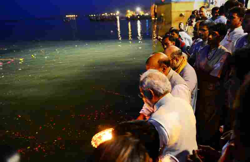 Indian prime minister-elect Narendra Modi (bottom left) offered prayers by the river Ganges in a religious ceremony beamed live on television that underlined his Hindu nationalist roots a day after his stunning electoral triumph.