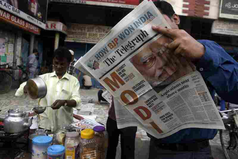 A man reads a newspaper with opposition leader Narendra Modi featured in the headlines in Gauhati, India, on Saturday.